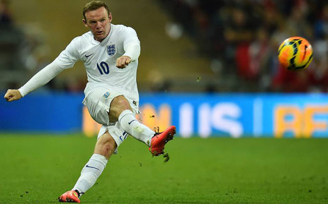 England's Wayne Rooney takes a shot. Picture: AFP.