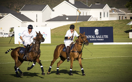 Prince Harry takes aim during a polo match at Val de Vie Estate in Paarl. Picture: Thomas Holder/EWN.