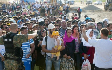Migrants wait at the new reception center near the town of Gevgelija, on the Macedonian-Greek border on August 23, 2015. Picture: AFP.
