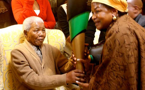 Former President Nelson Mandela receives a symbolic flame from ANC Chairperson Baleka Mbete on 30 May 2012. It was his first appearance in public since being hospitalised in January. Picture: ANC
