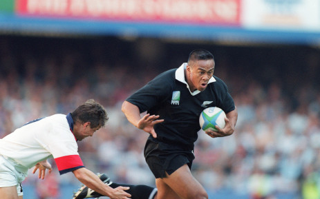 FILE: Former New Zealand winger Jonah Lomu runs through England's fullback Mike Catt during the Rugby World Cup semi-final match between New Zealand and England 18 June 1995 in Cape Town. Picture: AFP