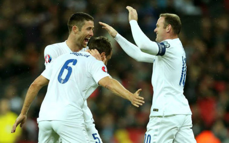 England's Gary Cahill and Wayne Rooney celebrate with Phil Jagielka after scoring the openening goal in their Euro 2016 qualifier against San Marino on 9 October 2014. Picture: Facebook.