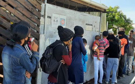 FILE: Hungry residents queue outside the Tafelsig Mitchells Plain CAN initiative. Picture: Tafelsig Mitchells Plain CAN/Facebook