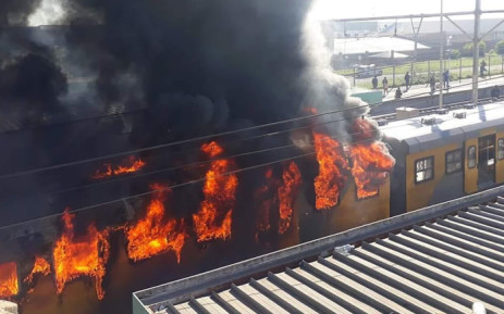 A Metorail train on fire at the Koeberg station in Cape Town on 21 August 2018. Picture: One Second Traffic Alerts