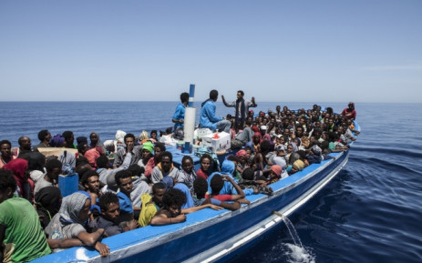 FILE: Migrants seen aboard a wooden boat on the Mediterranean sea. Picture: AFP.