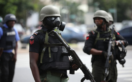 FILE: Riot policemen wearing masks stand in a street during a violent protest on 23 July 2019 in Abuja. Picture: AFP