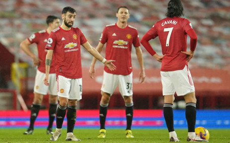 Manchester United midfielder Bruno Fernandes (L) and teammates react after conceding their second goal during the English Premier League football match between Manchester United and Sheffield United at Old Trafford in Manchester, north west England, on 27 January 2021. Picture: Dave Thompson /AFP