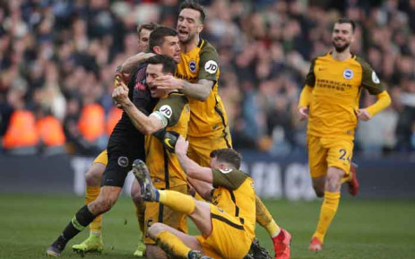 Brighton's English midfielder Solly March (L), Brighton's Australian goalkeeper Mathew Ryan (2nd L) Brighton's English defender Lewis Dunk (C), Brighton's Irish defender Shane Duffy (top) and Brighton's English midfielder Dale Stephens (2nd R) celebrate winning the penalty shoot-out during the English FA Cup quarter-final football match between Millwall and Brighton and Hove Albion at The Den in south London on 17 March 2019. Brighton won the penalty shoot-out 5-4 after the game ended 2-2 after extra time. Picture: AFP