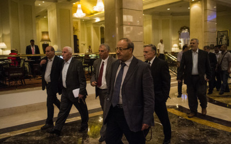 Head of the Palestinian delegation Azzam al-Ahmed (2L) and others members of the delegation arrive at the hotel after a meeting with Egyptian senior intelligence in Cairo on 11 August, 2014. Picture: AFP.