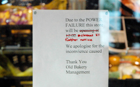 FILE: A business notifies customers of its closure due to power cuts. Picture: AFP