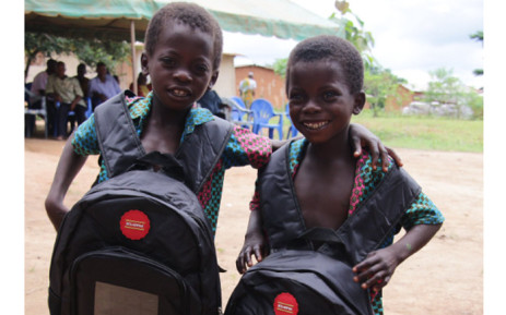Two schoolchildren with the solar backpacks provided by Ivorian charity Yiwo Zone.  Picture: Twitter/YiwoZone