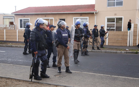 FILE: Police monitor the Parkwood area as residents protest for land. Picture: EWN