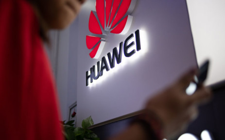 FILE: In this photo taken on 27 May 2019, a Huawei logo is displayed at a retail store in Beijing. Picture: AFP