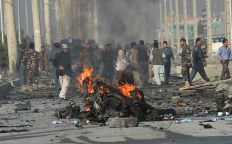 A suicide bomber blew herself up alongside a minivan carrying foreigners on a major highway leading to the international airport in the Afghan capital, police said, killing at least 10 people, including nine foreigners. Picture: AFP.