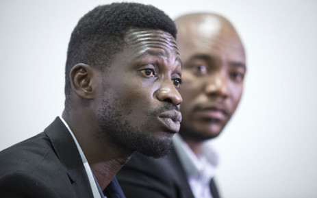 FILE: Pop star turned Uganda's leading opposition figure Bobi Wine (L), attends a briefing on the state of freedom in African politics in Johannesburg, South Africa, on 12 December 2019. Picture: AFP