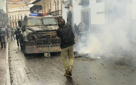 A demonstrator gestures at riot police during a transport strike against the economic policies of the government of Ecuadorean President Lenin Moreno regarding the agreement signed on March with the International Monetary Fund (IMF), in Quito, on October 3, 2019. Picture: AFP.