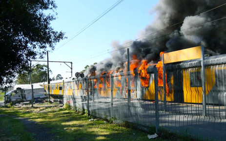A Metrorail train burns after crashing into a vehicle near Stellenbosch. Picture: Gordon Hiles/EWN