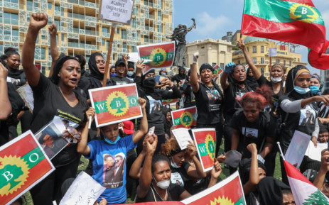 Members of the Oromo Ethiopian community in Lebanon take part in a demonstration to protest the death of musician and activist Hachalu Hundessa, in the capital Beirut on 5 July 2020. Hundessa was shot and killed in the Ethiopian capital Addis Ababa on 29 June 2020. His death has sparked ongoing protests around the world. Picture: AFP