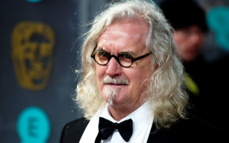 Scottish comedian and actor Billy Connolly poses on the red carpet upon arrival to attend the annual BAFTA British Academy Film Awards at the Royal Opera House in London on 10 February 2013. Picture: Andrew Cowie/AFP