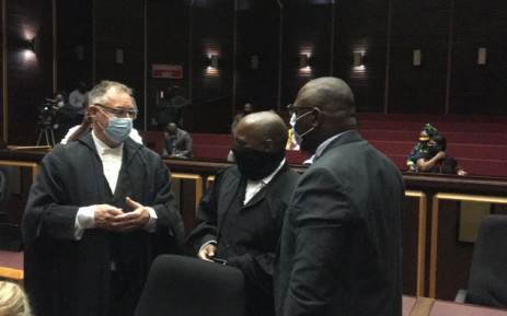 Jacob Zuma's legal team and senior State prosecutor Advocate Billy Downer exchange a few words in the Pietermaritzburg High Court on 23 February 2021. Picture: Nkosikhona Duma/Eyewitness News
