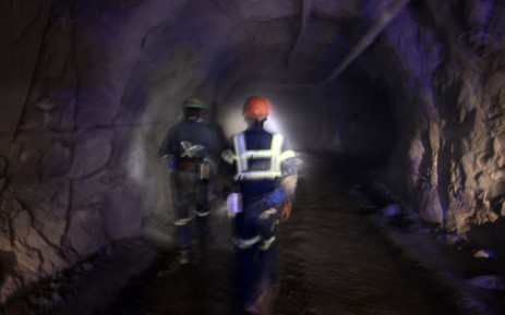 FILE: Miners walk down a mine shaft. Picture: AFP