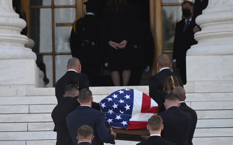 The flag-draped casket of the late US Supreme Court Justice Ruth Bader Ginsburg arrives at the US Supreme Court in Washington, DC, 23 September 2020. Picture: AFP.