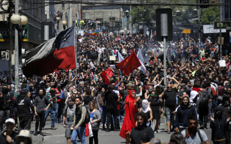 Demonstrators protest in Valparaiso, Chile, on 21 October 2019. Chile's death toll has risen to 11, authorities said on Monday, after three days of violent demonstrations and looting that saw President Sebastian Pinera claim the country was 'at war'. Picture: AFP