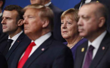 France's President Emmanuel Macron (L) and German Chancellor Angela Merkel (2R) pose with Nato leaders including US President Donald Trump (2L) and Turkey's President Recep Tayyip Erdogan (R) for the family photo at the Nato summit at the Grove hotel in Watford, northeast of London on 4 December 2019. Picture: AFP.