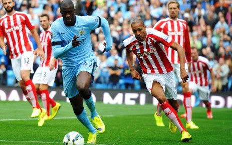 """""""Manchester City's Yaya Toure (L) vies for the ball with Steven N'Zonzi of Stoke City during the English Premier League match between Manchester City and Stoke at the Etihad stadium in Manchester, Britain, 30 August 2014. Picture: EPA."""