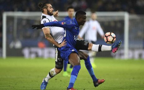 FILE: Leicester City's Ghanaian midfielder Daniel Amartey (R) tries to hold off Derby's English midfielder Bradley Johnson (L) during the English FA Cup fourth round replay football match between Leicester City and Derby County at King Power Stadium in Leicester, central England on 8 February 2017. Picture: AFP.