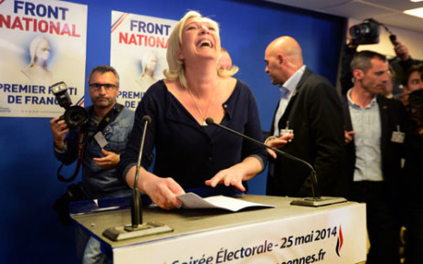 French far-right Front National (FN) party president Marine Le Pen reacts at the party's headquarters in Nanterre, outside Paris, on 25 May 2014. Picture: AFP/PIERRE ANDRIEU