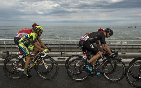 Spain's Alberto Contador and Brit Chris Froome ride the pack in the Tour de France on 5 July 2015. Picture: AFP.