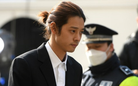 K-pop star Jung Joon-young (C) arrives for questioning at the Seoul Metropolitan Police Agency in Seoul on 14 March 2019. Picture: AFP