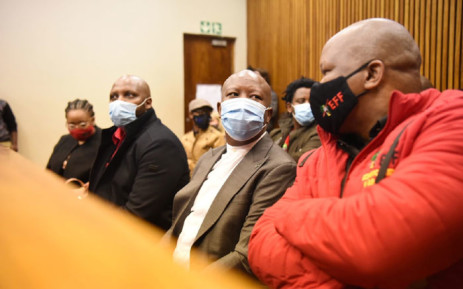 Economic Freedom Fighters (EFF) leader Julius Malema (wearing brown jacket) appears in the Randburg Magistrates Court on 13 October 2020. Picture: @EFFSouthAfrica/Twitter