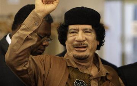 Libyan leader Col. Muammar Gaddafi gestures as he enters the U.N. headquarters for the UN General Assembly on 23 September 2009. AFP