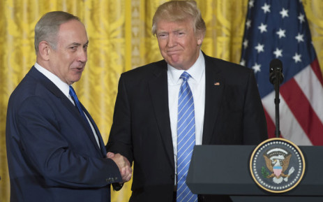 FILE: US President Donald Trump (R) and Israeli Prime Minister Benjamin Netanyahu shake hands following a joint press conference in the East Room of the White House in Washington, DC, February 15, 2017. Picture: AFP