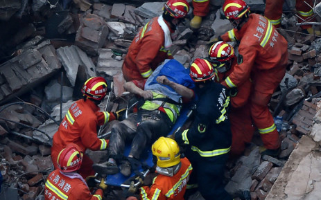 Members of a rescue team carry out a survivor of a building collapse in Shanghai on 16 May 2019. Picture: AFP