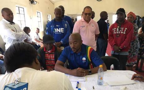 DA leader Mmusi Maimane checks his voter registration details at the Presbyterian church in Soweto. Picture: Katleho Sekhotho/EWN.