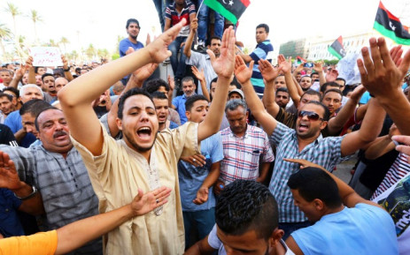 Libyans take part in a demonstration in the capital Tripoli on 31 July 2014, calling for international intervention to protect civilians. Picture: AFP.