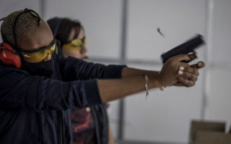 A spent shell leaves a pistol fired by a woman as she takes part in training organised by the women empowerment group Girls on Fire, in Midrand, on 7 February 2021. Picture: MARCO LONGARI/AFP