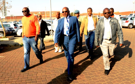 FILE: Former police crime intelligence boss Richard Mdluli (C) arrives at the Palm Ridge Magistrates Court with an entourage of men on Monday, 11 August 2014. Picture: Sapa.