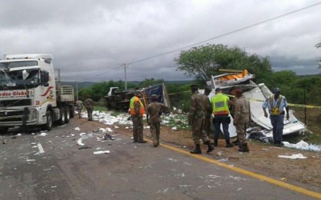 SANDF members and police investigate the crash scene. Picture: SAPS