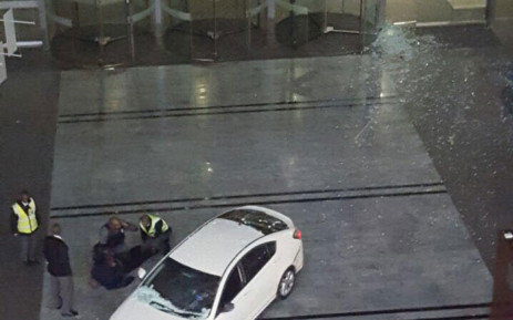A 48-year-old man drove his car into the glass wall of the Standard Bank offices in Rosebank on 14 September 2016. Picture: Supplied.