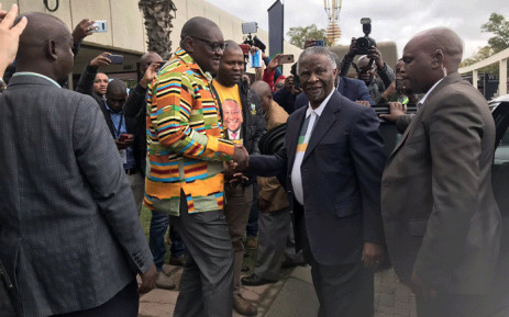 The ANC's David Makhura welcomes former President Thabo Mbeki as he arrives at the Nasrec Expo for a tour of the ANC pavilion. Picture: @GautengANC/Twitter.