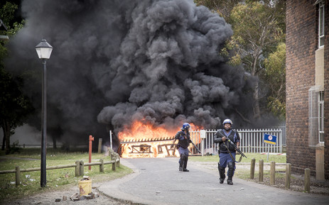 FILE: Police sweep and clear the University of the Western Cape campus during violent clashes with students. Picture: Thomas Holder/EWn
