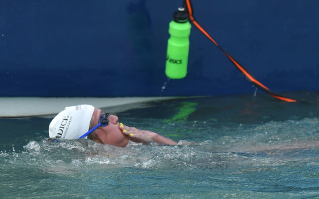 Australian marathon swimmer Chloe McCardel takes sustenance during her 10-hour swim across the English Channel for a world record-breaking 44th time, on her way from Kent on the English coast to Wissant Beach, near Pointe de la Courte Dune on the French coast on October 13, 2021. Picture: AFP.