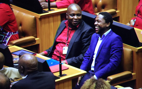 FILE: The EFF's Floyd Shivambu and Mbuyiseni Ndlozi (right) share a laugh during the 2015 Sona debate in Parliament on 17 February 2015. Picture: Thomas Holder/EWN.