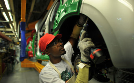 A worker on a car assembly line. Picture: AFP