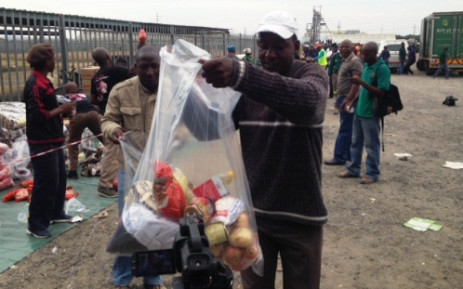 The Gift of the Givers hands out food parcels to striking Amcu miners at Anglo American Platinum in Rustenburg on 20 May 2014. Picture: Vumani Mkhize/EWN
