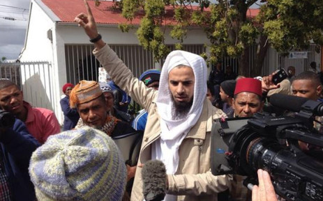 Several protesters from the Muslim faith gatheroutside the new 'open Mosque' in Wynberg on 19 September 2014. Picture: Aletta Garner/EWN.